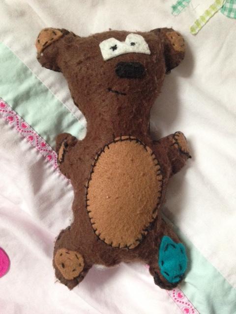 cuddled teddy